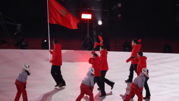 Flag bearer Samir Azzimani of Morocco leads his country during the Opening Ceremony of the PyeongChang 2018 Winter Olympic Games. Samir Azzimani is a Moroccan-French cross-country skier.