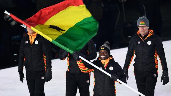 The country's flagbearer Akwasi Frimpong leads the delegation as they parade during the opening ceremony. Frimpong is a Dutch-Ghanaian sprinter. He is also the first Ghanaian-born athlete to represent the country in Skeleton.