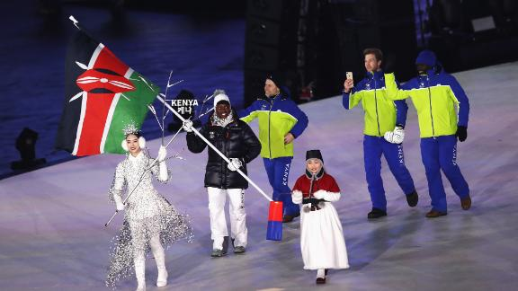 Sabrina Simander is the flag bearer of Kenya. Simader was born in Kenya to an Austrian father and Kenyan mother. She moved to Austria when she was young and learnt to ski there.