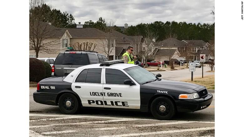 The Locust Grove officer was backing up two deputies serving a warrant, authorites said.