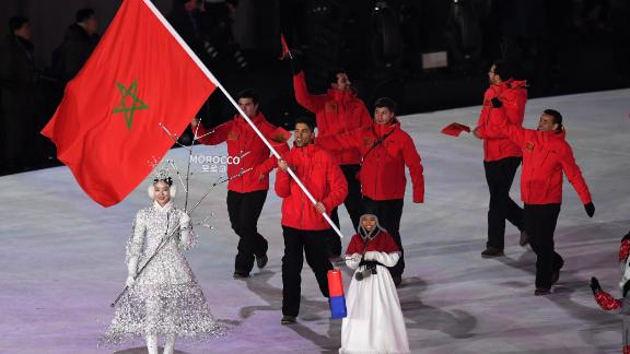 Moroccan teammates enter the stadium during the Opening Ceremony of the PyeongChang 2018 Winter Olympic Games. Alpine skier Adam Lamhamedi is the second Moroccan athlete.