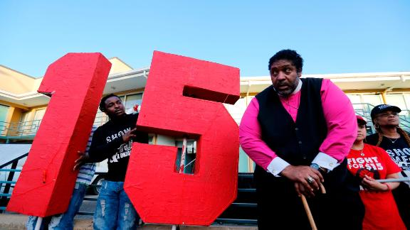 MEMPHIS, TN - APRIL 04:  The Rev. William J. Barber II (R) stands outside the National Civil Rights Museum following a march from City Hall to the museum by Fight for $15 supporters on April 4, 2017 in Memphis, Tennessee. About 1,000 people marched through downtown Memphis from City Hall to the National Civil Rights museum on the 49th anniversary of Dr. Martin Luther King, Jr.