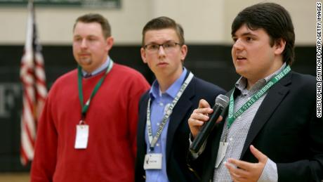 Jack Bergeson, 16, of Wichita, Kansas speaks during a forum with some of the four teenage candidates for Kansas Governor at Free State High School in Lawrence, Kansas on October 19, 2017, joined by Ethan Randleas, 17, of Wichita,and  Jack's running mate Lt. Gov. Candidate Alexander Cline(C), 17, of Wichita. The state of Kansas has no age restrictions for gubernatorial candidates. The mid-term election will be held on November 6, 2018. / AFP PHOTO / Christopher Smith        (Photo credit should read CHRISTOPHER SMITH/AFP/Getty Images)