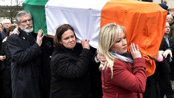 Gerry Adams (L), Mary Lou McDonald (C) and Sinn Fein northern leader Michelle O'Neill  carry the coffin of the late Martin McGuinness in March 2017.