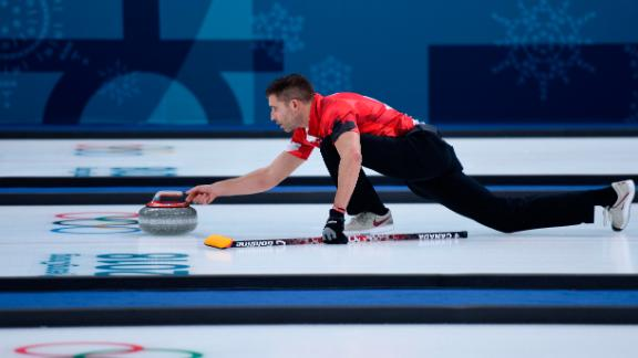 Canada's John Morris competes in the mixed curling round robin against Switzerland.