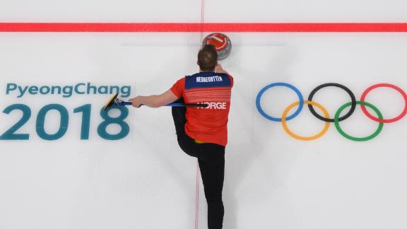 Norway's Magnus Nedregotten slides the stone during the mixed curling round robin.