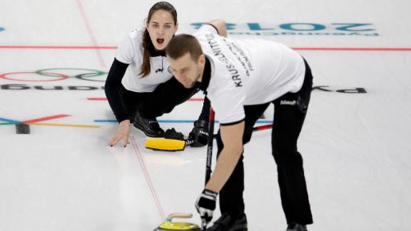 Olympic Athlete from Russia Anastasia Bryzgalova makes a call to her teammate Aleksandr Krushelnitckii during a mixed curling match against South Korea's Jang Hyeji and Lee Kijeong.