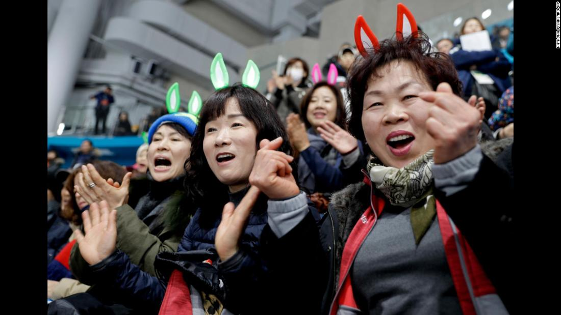 South Korean fans cheer their team during a mixed curling match against Olympic Athletes from Russia.