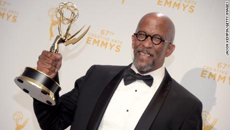 "Reg E. Cathey holds an Emmy he won in 2015 for outstanding guest actor in a drama for his work on ""House of Cards."""