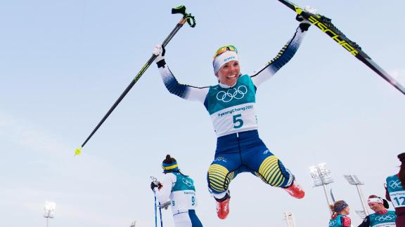 Sweden's Charlotte Kalla celebrates after winning the first gold medal of the Games.