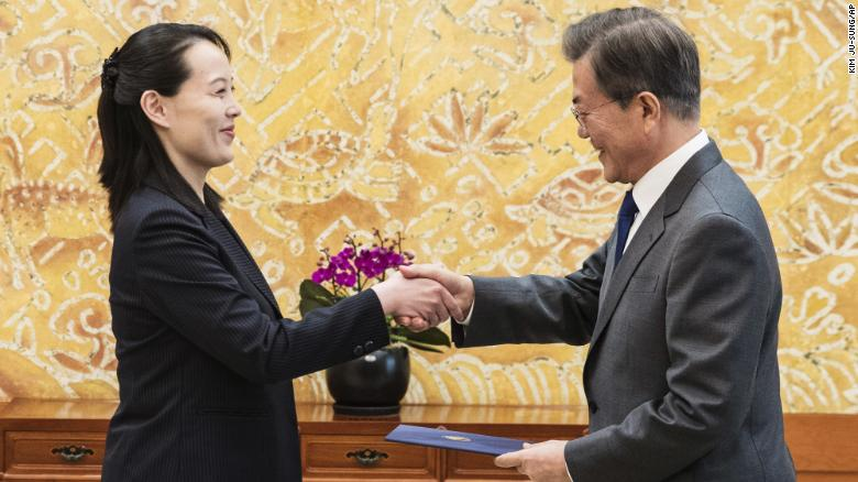 """South Korean President Moon Jae-in, right, shakes hands with Kim Yo Jong, North Korean leader Kim Jong Un's sister, after receiving a letter at the presidential house in Seoul, South Korea, Saturday, Feb. 10, 2018. A rare invitation to Pyongyang for the South Korean president marked Day Two of the North Korean Kim dynasty's southern road tour Saturday, part of an accelerated diplomatic warming that included more handshakes, some Korean liquor over lunch and the potential shared joy of watching a """"unified"""" Korea team play hockey at the Olympics."""