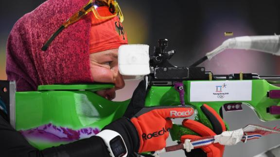 Germany's Laura Dahlmeier prepares for competition in the women's biathlon 7.5-kilometer sprint.