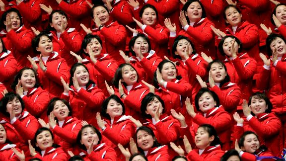 North Korean fans cheer as they watch a short track speedskating race. Choe Un-song was competing in the 1,500 meters. He is one of 22 North Koreans who will be taking part in the Winter Games in Pyeongchang.