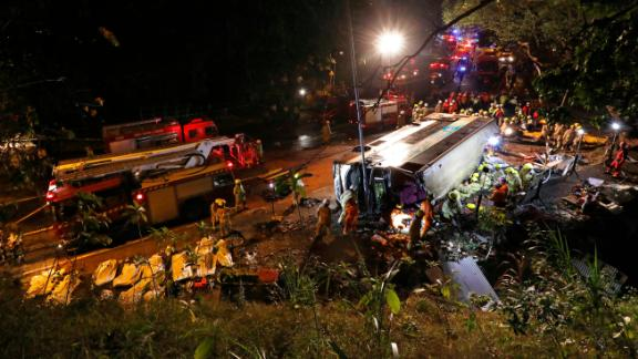 Firemen work at the scene where a double-decker bus crashed on Saturday, February 10, 2018, in Hong Kong.