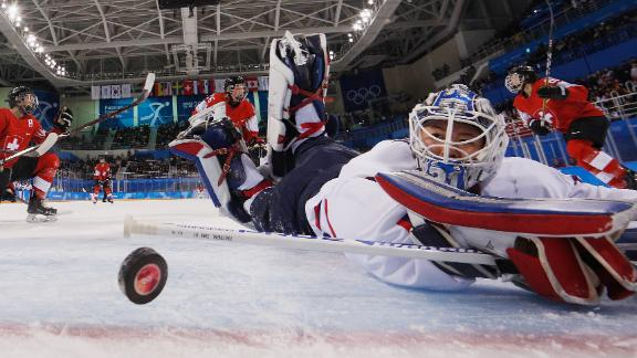 Phoebe Staenz of Switzerland scores a goal against Shin So-jung of Korea in the second period of play during the women's ice hockey preliminary round.