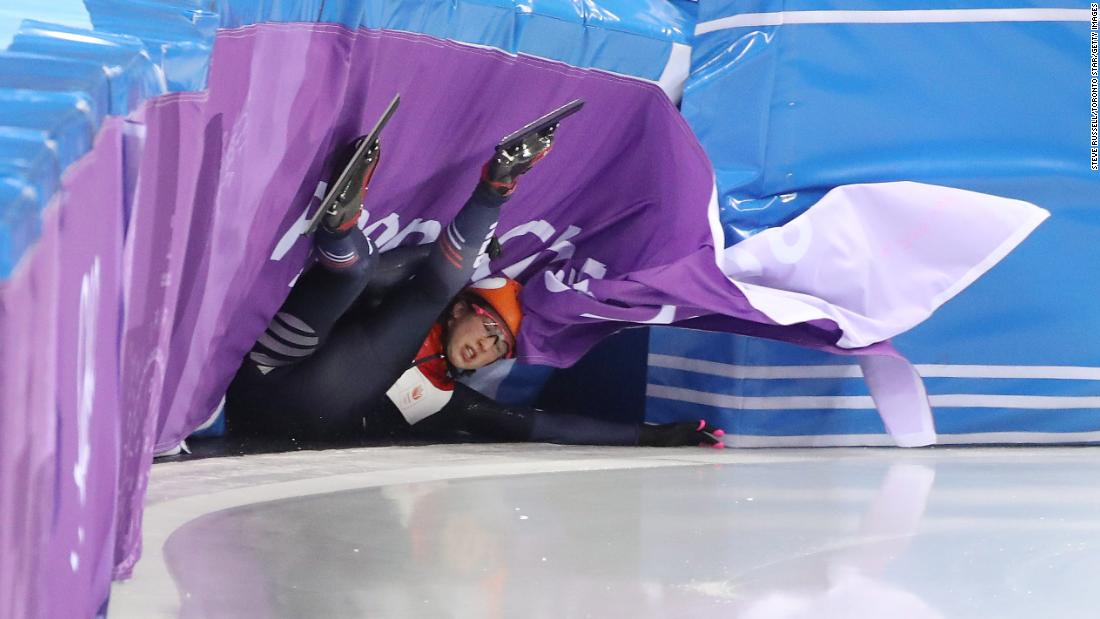 Suzanne Schulting of the Netherlands crashes in her 500-meter heat in short track speedskating.