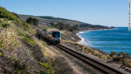 "SANTA BARBARA, CA - DECEMBER 24:  An Amtrak ""Surfrider"" train runs along the coast near El Capitan State Beach on December 24, 2014, in Santa Barbara, California. Because of its close proximity to Southern California and Los Angeles population centers, the coastal region of Santa Barbara has become a popular weekend getaway destination for millions of tourists. (Photo by George Rose/Getty Images)"