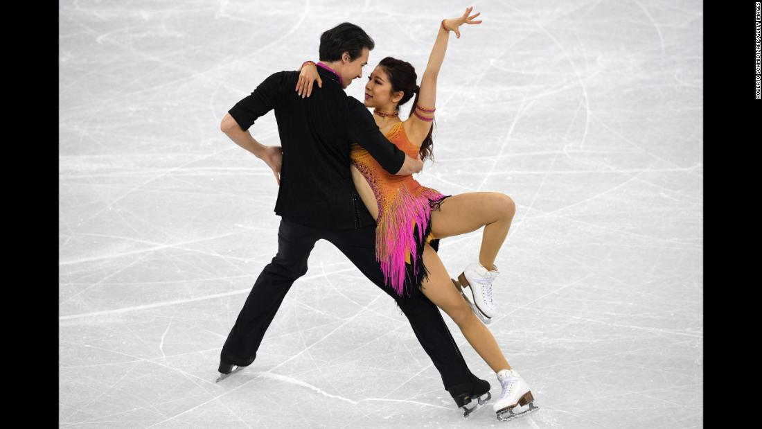 Japan's Kana Muramoto and Chris Reed compete in the team figure skating short dance event.