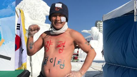 "A runner used his chest to declare ""Go Yangpyeong!"" -- a region in South Korea."
