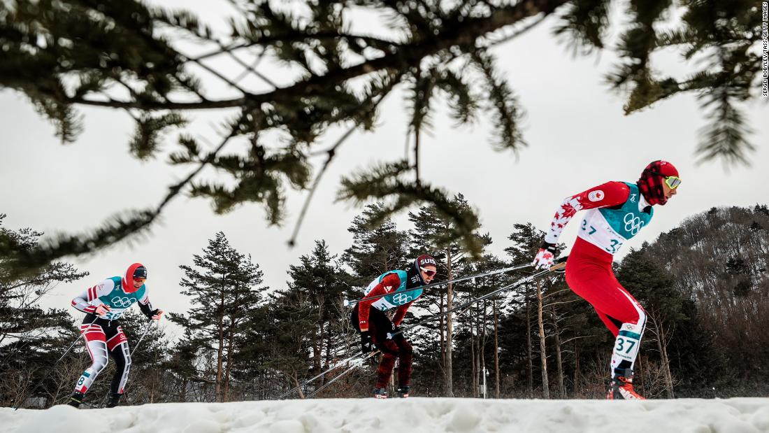 Cross-country skiers compete in the men's 15km + 15km skiathlon race.