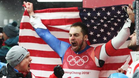 Chris Mazdzer of the United States celebrates after winning the silver medal following run 4 during the luge men's singles.