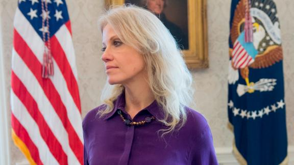 White House Counselor Kellyanne Conway as US President Donald Trump speaks to the press in the Oval Office of the White House in Washington, DC, February 9, 2018. / AFP PHOTO / SAUL LOEB        (Photo credit should read SAUL LOEB/AFP/Getty Images)