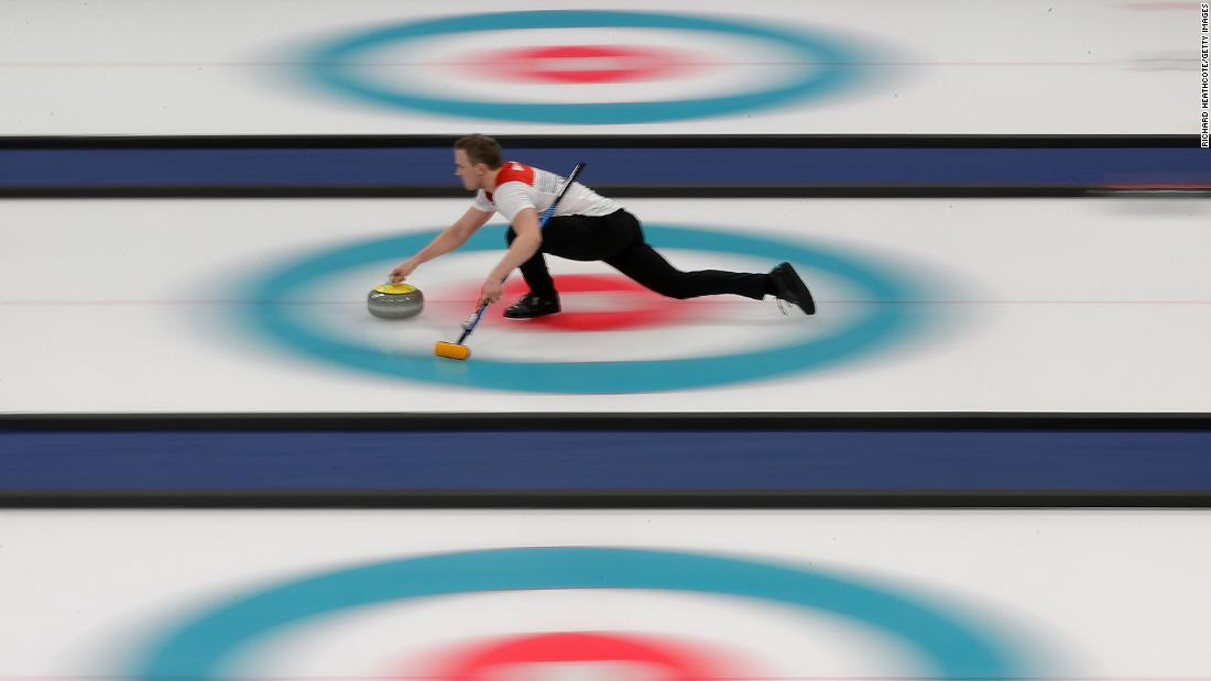 Norway's Magnus Nedregotten and Kristin Skaslien, out of frame, compete in a curling mixed doubles tie-breaker against Dexin Ba and Rui Wang of China.