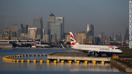 A plane waits on the runway at London City Airport.