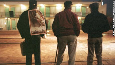 In 1998, three former Memphis sanitation workers -- from left to right, Eugene Brown, James Jones and Lafayette Shields -- stand silhouetted in the lights of the National Civil Rights Museum after a memorial service for the late Dr. Martin Luther King in Memphis, TN. Brown and Jones were part of the original sanitation workers strike, 30 years ago, that brought Dr. King to Memphis before he was killed by a sniper. Hundreds turned out for a 30th anniversary vigil at the former Lorraine Motel, now the National Civil Rights Museum, where King was slain as he stepped from his room in 1968.