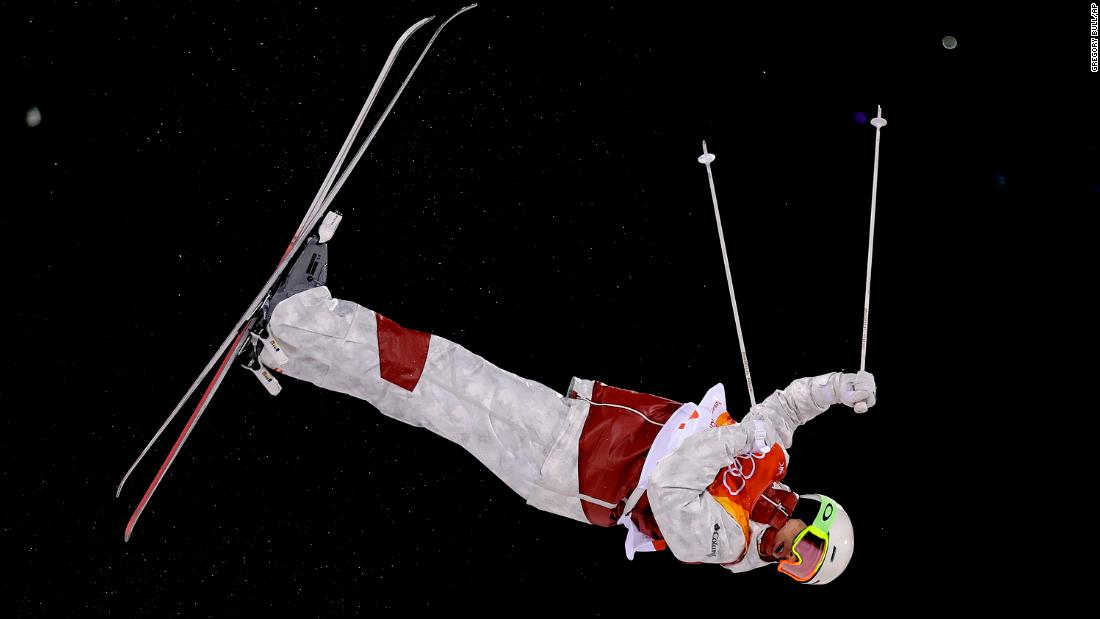 Canadian skier Mikael Kingsbury catches some air on his way to winning gold in the moguls.