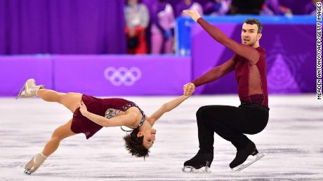 Meagan Duhamel and Eric Radford skate to Adele as Canada win team gold.
