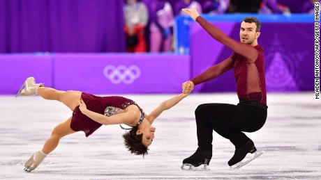 Canada's Meagan Duhamel and Canada's Eric Radford compete in the figure skating team event pair skating free skating during the Pyeongchang 2018 Winter Olympic Games at the Gangneung Ice Arena in Gangneung on February 11, 2018. / AFP PHOTO / Mladen ANTONOV        (Photo credit should read MLADEN ANTONOV/AFP/Getty Images)