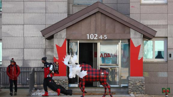 Team Canada members walk in the PyeongChang Olympic Village during a media tour before the start of the PyeongChang 2018 Olympic Games on February 6.