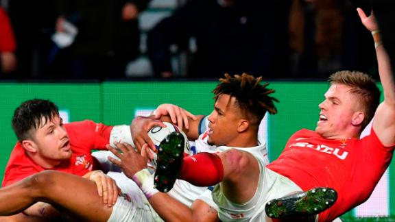 After Anthony Watson (C) and Gareth Anscombe (R) dived at a kick in England