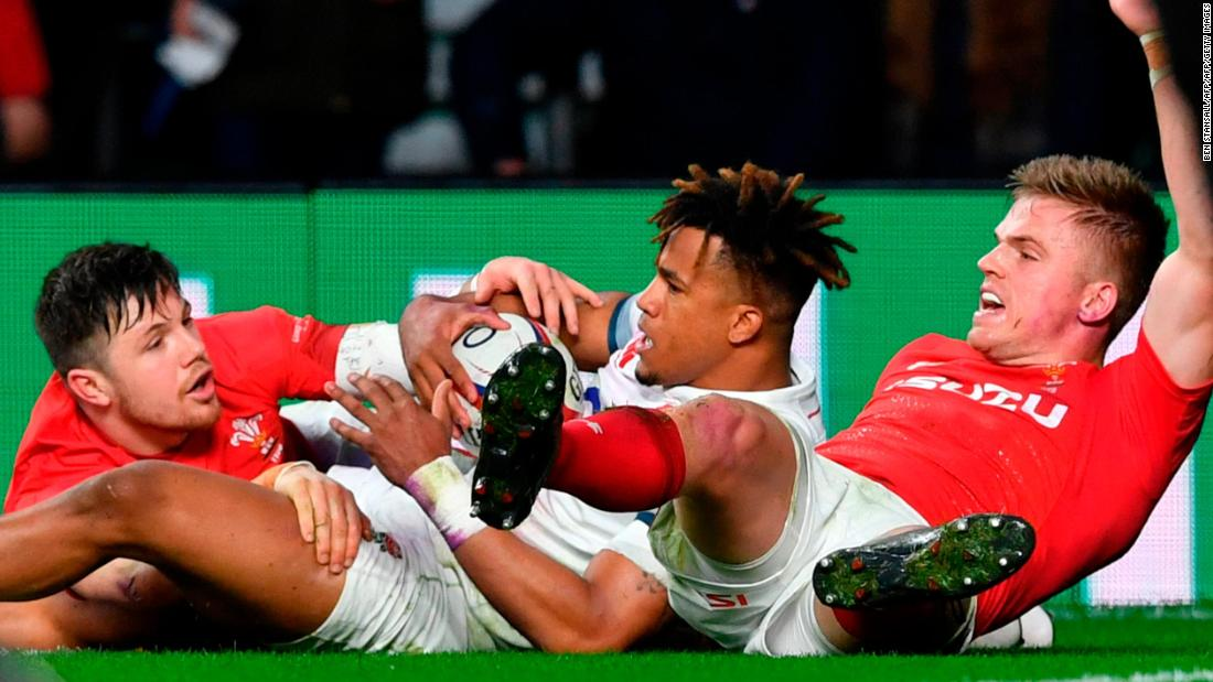 "After Anthony Watson (C) and Gareth Anscombe (R) dived at a kick in England's in-goal area, the television match official ruled that Watson had touched the ball down first. Wales coach Warren Gatland felt his side was denied a try, calling the decision a ""terrible mistake"" in what turned out to be a tightly-contested affair."