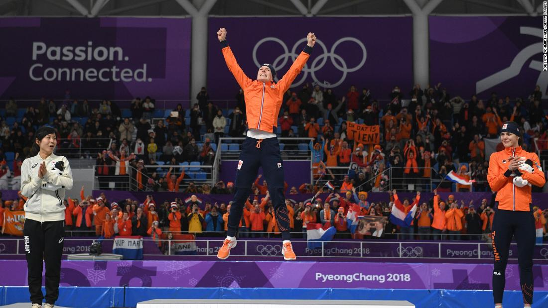 Dutch speedskater Ireen Wust celebrates on the podium after winning the 1,500 meters. Wust now has 10 medals in her career, making her the most decorated skater in Olympic history.
