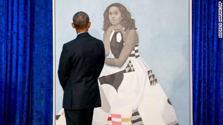 Former President Barack Obama, looks at former first lady Michelle Obama's official portrait at the Smithsonian's National Portrait Gallery, Monday, Feb. 12, 2018, in Washington.