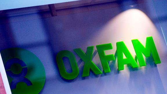 The logo on the front of an Oxfam bookshop is photographed in Glasgow on February 10, 2018.  The British Government announced late on February 9 it was reviewing all work with Oxfam amid revelations the charity