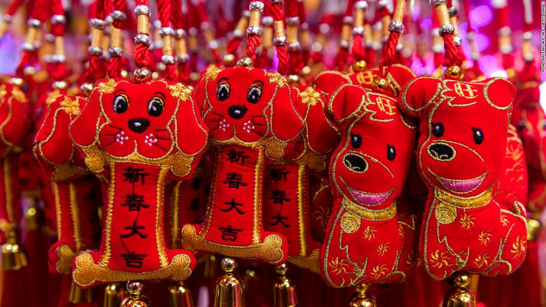Decorative dog figurines are seen for sale ahead of the Lunar New Year celebrations in Kuala Lumpur's Chinatown on January 26, 2018.