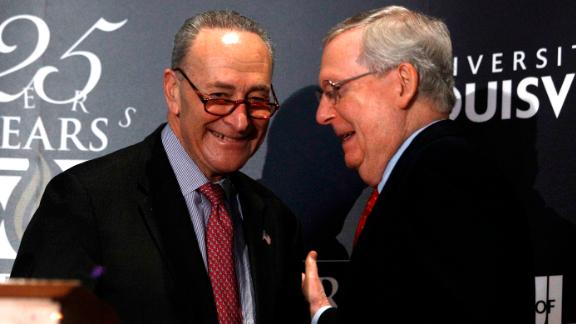 McConnell (right) (R-KY) and Schumer (D-NY) shake hands after Shumer delivered a speech and answered questions at the University of Louisville's McConnell Center on Monday in Louisville, Kentucky.  (Bill Pugliano/Getty Images)