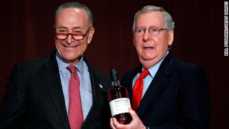 LOUISVILLE, KY - FEBRUARY 12: U.S. Senate Democratic Leader Chuck Schumer  (left) (D-NY), presents U.S. Senate Majority Leader Mitch McConnell (right) (R-KY) with a bottle of bourbon at the University of Louisville's McConnell Center where Schumer was scheduled to speak February 12, 2018 in Louisville, Kentucky. Sen. Schumer spoke at the event as part of the Center's Distinguished Speaker Series, and Sen. McConnell introduced him. (Bill Pugliano/Getty Images)