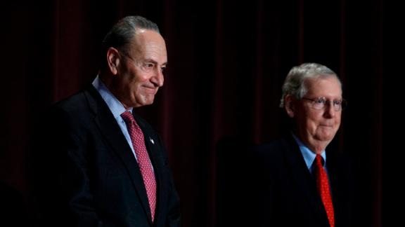 LOUISVILLE, KY - FEBRUARY 12: U.S. Senate Majority Leader Mitch McConnell (right) (R-KY) and U.S. Senate Democratic Leader Chuck Schumer (D-NY) stand on the stage together at the University of Louisville