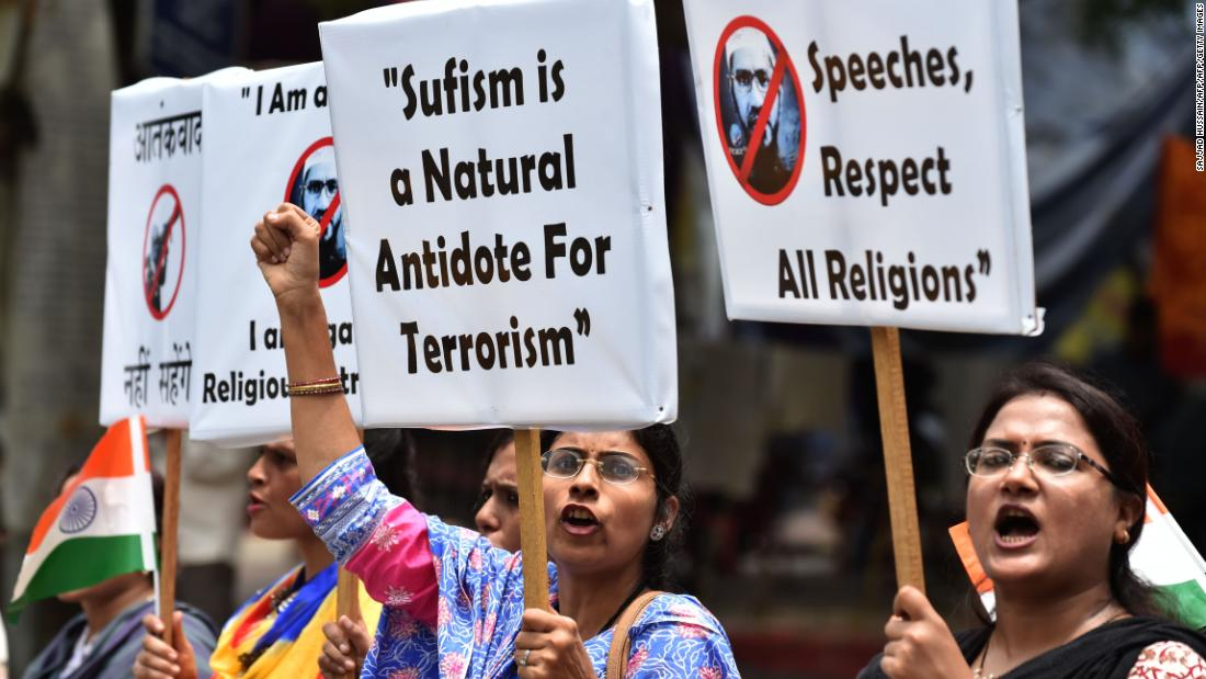 Indian protesters hold placards as they shout slogans during a protest denouncing Islamic scholar Zakir Naik in New Delhi on July 18, 2016.