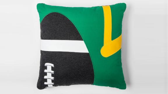 """<strong>Pillowfort Football Throw Pillow ($16.14; </strong><a href=""""https://www.target.com/p/football-throw-pillow-pillowfort-153/-/A-52845451"""" target=""""_blank"""" target=""""_blank""""><strong>target.com</strong></a><strong>)</strong>"""