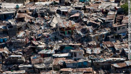 Houses in a poor neighborhood sit destroyed after an earthquake on January 13, 2010, in Port-au-Prince, Haiti.