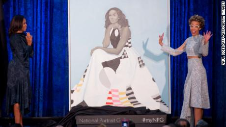 Former US First Lady Michelle Obama (L) and artist Amy Sherald (R) unveil Mrs. Obama's portrait at the Smithsonian's National Portrait Gallery in Washington, DC, February 12, 2018. / AFP PHOTO / SAUL LOEB        (Photo credit should read SAUL LOEB/AFP/Getty Images)