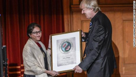 Pakistani human rights lawyer Asma Jahangir (L) receives the Right Livelihood Award from Jakob von Uexkull (R)  in Stockholm, Sweden, December, 2014.