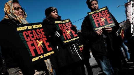 "BALTIMORE, MD - FEBRUARY 03:  Activists, residents and those that have lost a loved one to violence participate in a ""Peace and Healing Walk"" in an area with a high rate of homicides during Baltimore's third ""Ceasefire Weekend"" on February 3, 2018 in Baltimore, Maryland."
