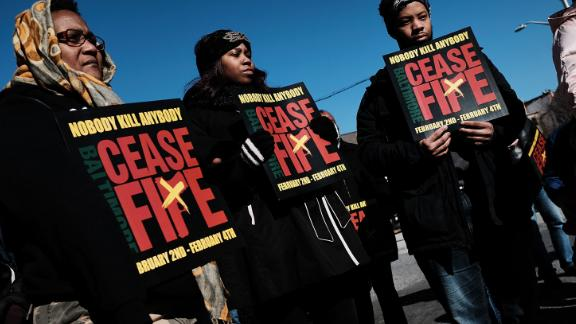 """BALTIMORE, MD - FEBRUARY 03:  Activists, residents and those that have lost a loved one to violence participate in a """"Peace and Healing Walk"""" in an area with a high rate of homicides during Baltimore's third """"Ceasefire Weekend"""" on February 3, 2018 in Baltimore, Maryland."""