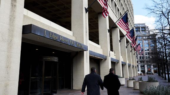 Pedestrians walk past the Federal Bureau of Investigation (FBI) headquarters in Washington, D.C., U.S., on Friday, Feb. 2, 2018. FBI and Justice Department officials got a warrant to spy on a Trump campaign associate by misleading a surveillance court judge, House Republicans contend in anewly released memothat Democrats have dismissed as a contrived account intended to protect the president. Photographer: T.J. Kirkpatrick/Bloomberg via Getty Images